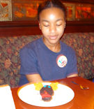 My granddaughter Fernan admiring her dessert at Le Cellier Steakhouse
