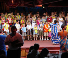 Children In The Audience Do A Routine At Disney's Spirit Of Aloha Dinner Show