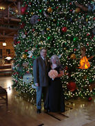 The Rosenhans in front of the Christmas Tree in the lobby of their home resort, The Wilderness Lodge Resort